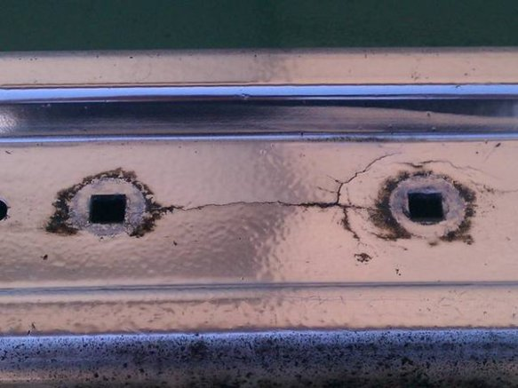 Stress cracks on an aluminum bumper as used on the BMW E23, E24, E28 and E30